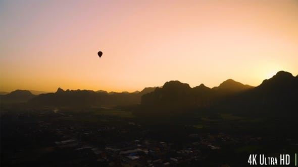 Thumbnail for 4K Hot Air Balloon Silhouette in Mountains at Sunset