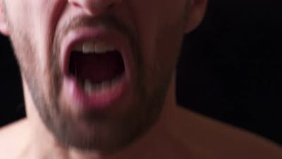 Close-up Mouth of Angry Man Screaming. Threat of Violence.