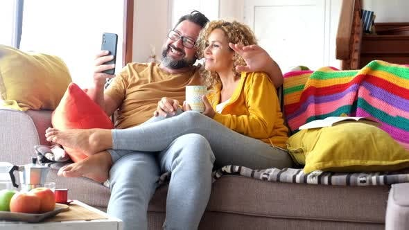 Home video phone call and couple of adult caucasian people enjoy technology
