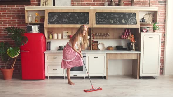 Thumbnail for Woman Mopping the Floor Cheerfully