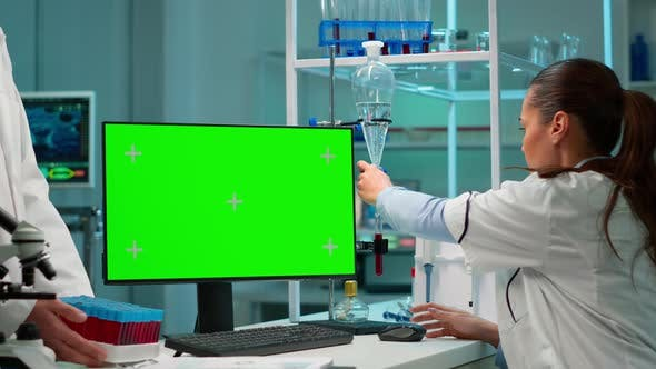 Thumbnail for Researcher Looking at Chroma Key Display in Modern Equipped Lab