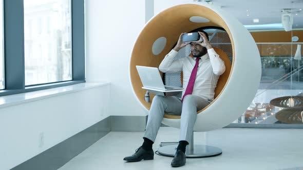 Businessman Meditating in Vr Headset