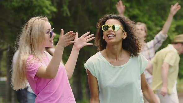 Cover Image for Best Friends Singing and Dancing at Open-Air Concert, Friends Enjoying Holidays