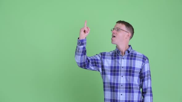 Thumbnail for Portrait of Happy Hipster Man Pointing Up and Giving Thumbs Up
