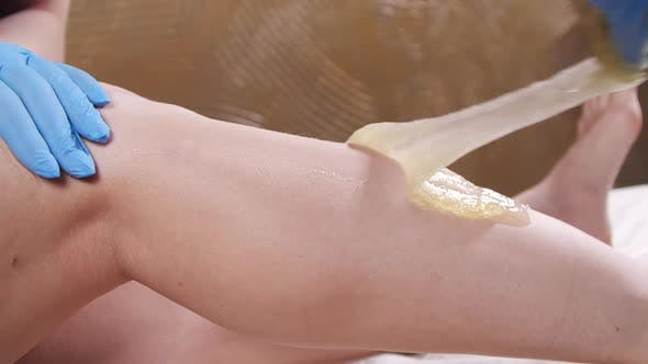 Thumbnail for Woman in Spa Getting Legs Waxed for Hair Removal in Slow Motion