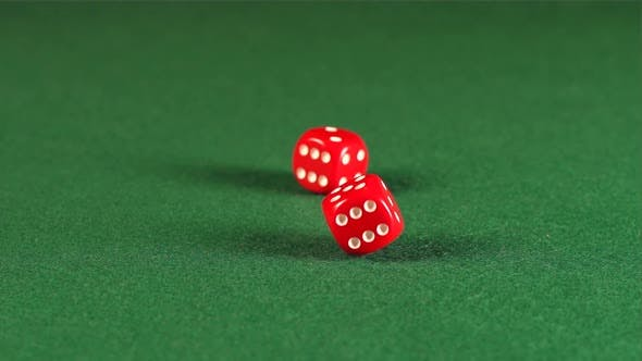Thumbnail for Two red cube rolls and stops on a green table