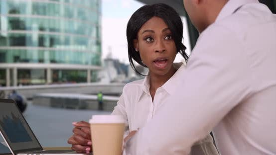 Thumbnail for Confident African-American businesswoman discusses business with potential client