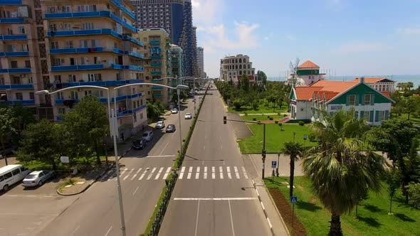 Thumbnail for Boulevard with cars between apartment buildings and seafront in Batumi Georgia