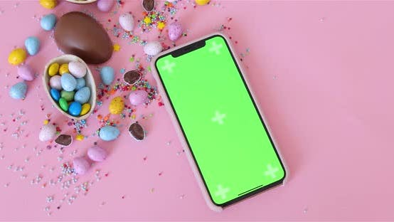 Thumbnail for Dolly Shot. Phone With Green Screen Lying Near Easter Decorations