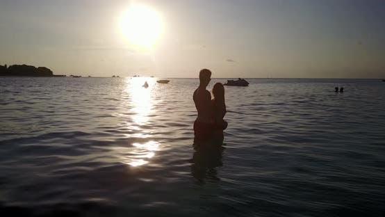 Thumbnail for Romantic boy and girl on romantic honeymoon enjoy life on beach on paradise white sand background