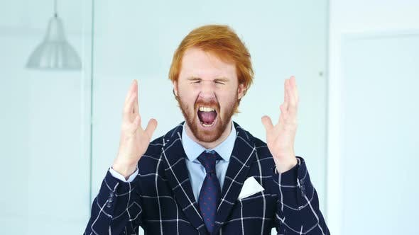 Thumbnail for Portrait of Screaming Upset Redhead Man in Office