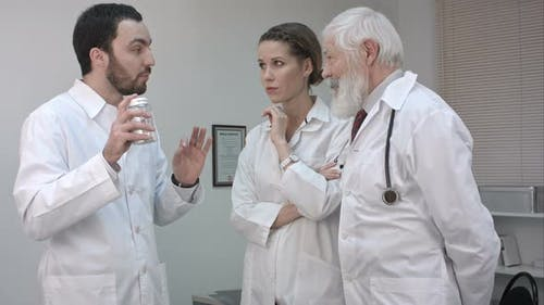 Doctor Holding a Medicine Bottle and Promoting To His Collegues