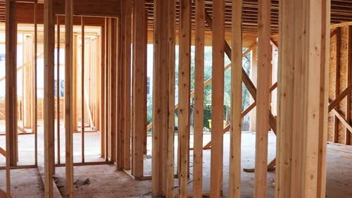 Open in industrial unfinished wood frame building or a house under construction