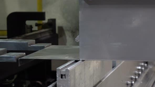 CNC Bending Machine. The Machine Bends the Metal Part