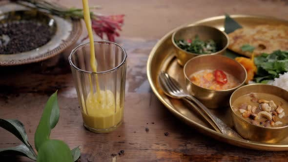Thumbnail for Beautiful and Homemade Fresh Indian Sri Lankian Drink - Mango Lassi. On Wooden Table, Garnished with