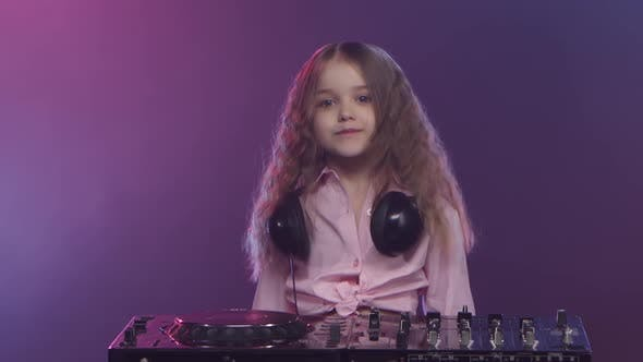 Thumbnail for Music on Dj Console Is Performed By Little Girl Musician