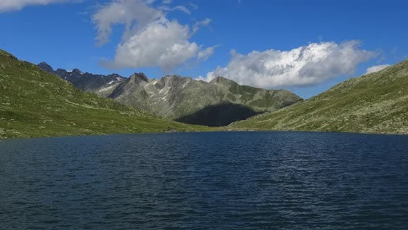 Thumbnail for Time-lapse view on peak of mountains and lake in Swiss Alps