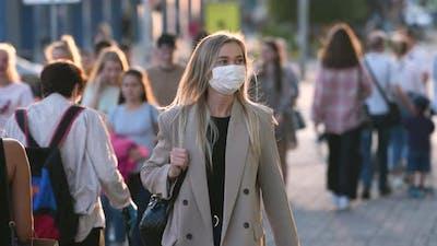 Woman in Coronavirus Facemask Walking on City Streets