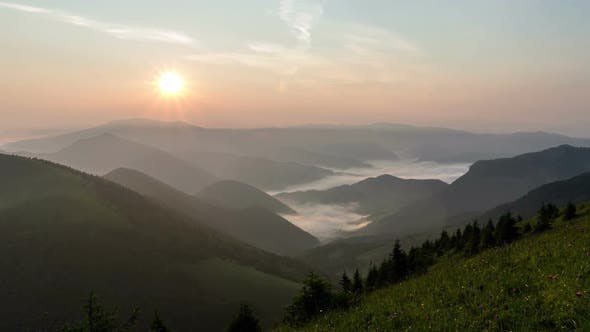 Thumbnail for Peaceful Evening Sunset over Green Alpine Mnature with Mist Clouds in Valley