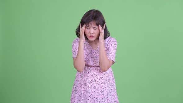 Thumbnail for Stressed Asian Pregnant Woman Having Headache