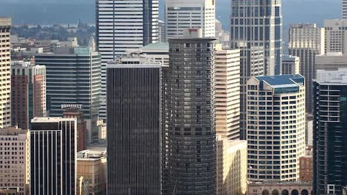 Panning zoomed view of the mid section of skyscrapers in Seattle.
