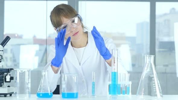 Thumbnail for Female Scientist Imagining New idea in Laboratory, Creative