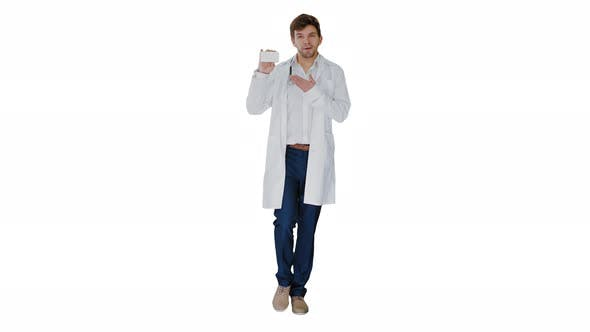 Walking Male Doctor Showing Empty White Box of Pills on White Background.