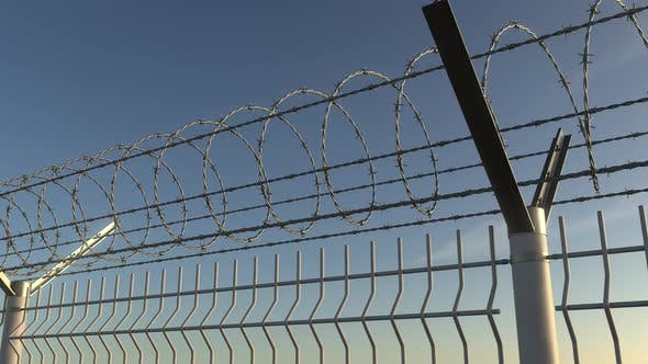 Thumbnail for Top of Barbed Wire Fence Against Sky