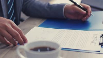 Close up manager signing agreement of the partnership.