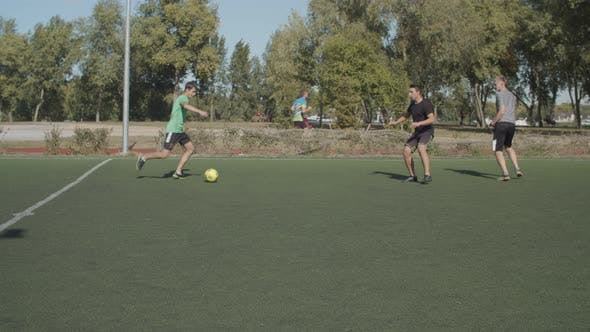 Thumbnail for Street Young Footballers Attacking Opposing Team