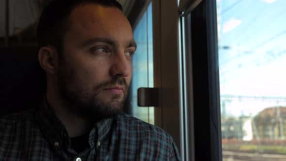 Thumbnail for Handsome Guy on Train Looking Out the Window