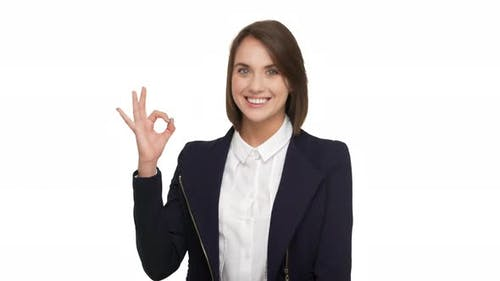 Portrait of Happy Smiling Female Proffesional Worker Posing in Office in Business Suit Gesturing