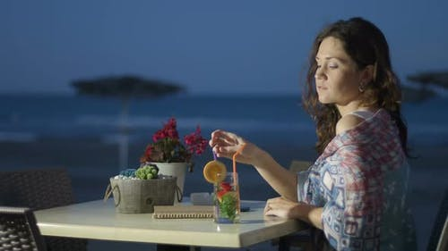 Relaxed Young Woman Drinking Cocktail at Beach Cafe, Romantic Lady Smiling