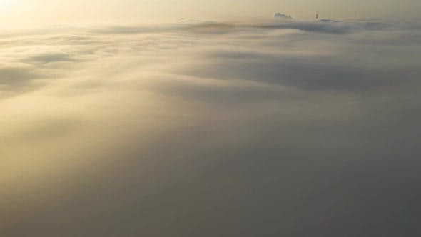 Thumbnail for Flying Over the Evening Timelapse Clouds with the Late Sun.