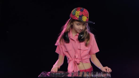 Thumbnail for Teenager Girl in Bright Cap Playing on the Dj Keyboard