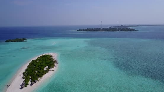 Thumbnail for Natural fly over travel shot of a sunshine white sandy paradise beach and blue water background in c