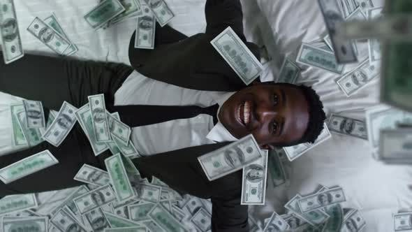 Thumbnail for Money Raining on Businessman in Bed