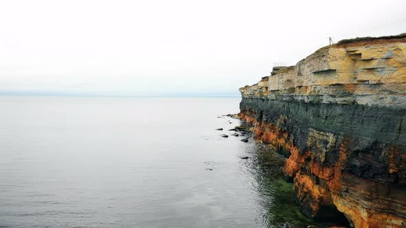 Thumbnail for Drone Is Moving Along Incredible Eroded Rocky Layers Coastline Above Amazing Quiet Sea Waters