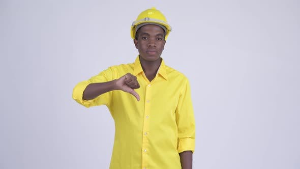 Cover Image for Young Stressed African Businessman As Engineer Giving Thumbs Down