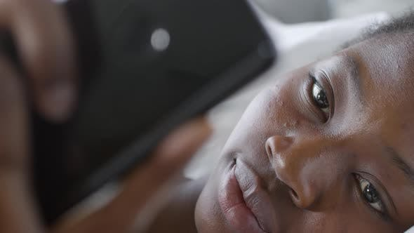 Thumbnail for Face of Woman Using Smartphone in Bed