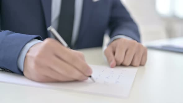Thumbnail for Businessman Writing on Paper