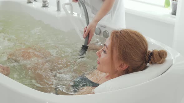 Thumbnail for Rear View Shot of a Woman Enjoying Hydromassage in Whirl Pool Bath
