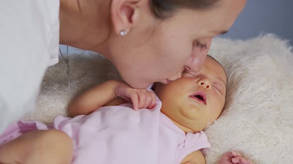 Thumbnail for Mother and Her Newborn Baby. Happy Mother Holding Her New Born Baby Girl Kissing and Hugging