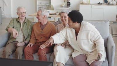 Seniors Watching Funny TV Program
