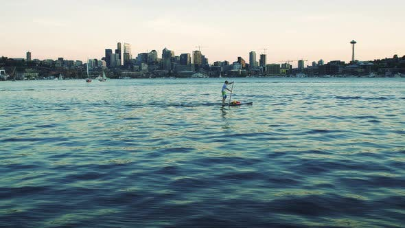 Thumbnail for Man Paddleboarding Lake Union With Seattle Skyline Background