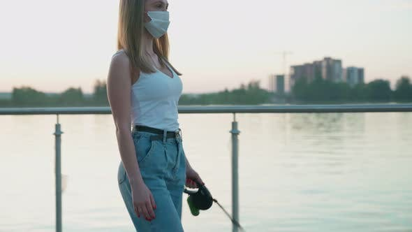 Thumbnail for Young Woman Wearing Face Mask Walking with Dog.