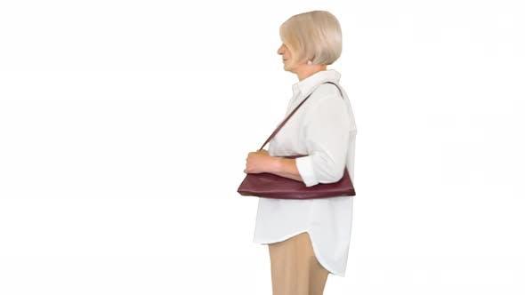 Senior Intelligent Woman Walking By on White Background