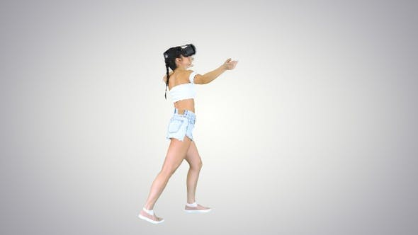 Cover Image for Woman using VR Virtual Reality headset walking and dancing