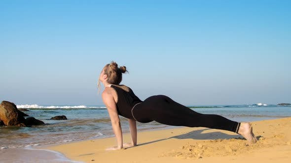 Thumbnail for Barefoot Girl Relaxes After Yoga Exercises on Sandy Beach