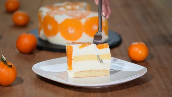 Thumbnail for Eating a piece of tangerine mousse cake.